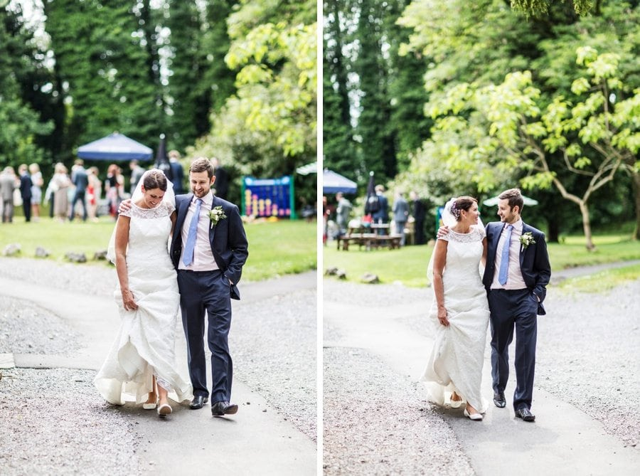 bride and groom walking down path at pencoed house near cardiff