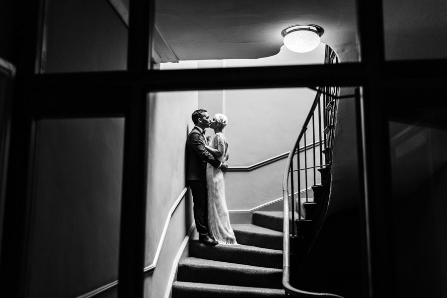 bride and groom embracing om stairwell at a wedding in the Angel Hotel in Abergavenny.
