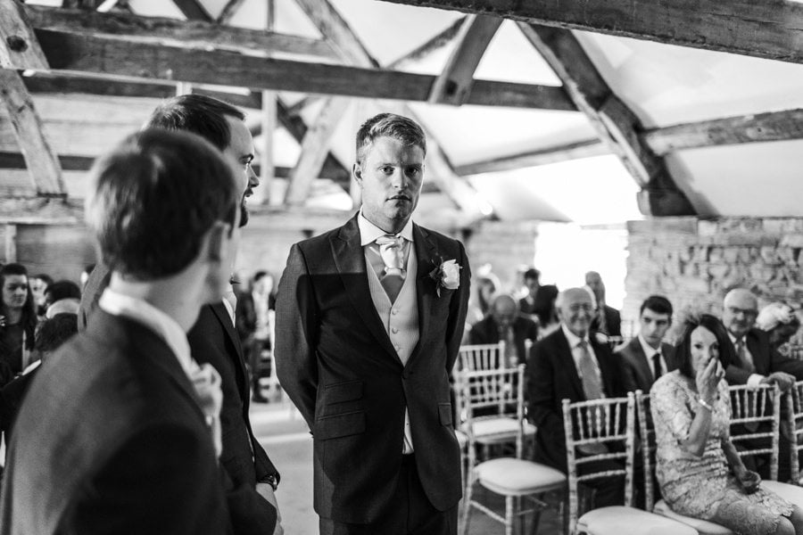 groom waiting for bride at a almonry barn wedding