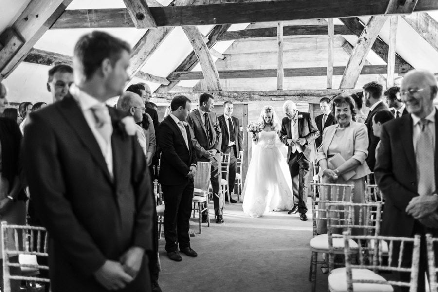 bride arriving at a almonry barn wedding