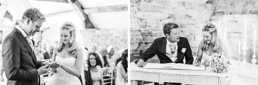 bride and groom exchanging rings and signing registrat at a almonry barn wedding