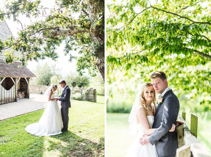 drie and groom embracing on a sunny day at a almonry barn wedding