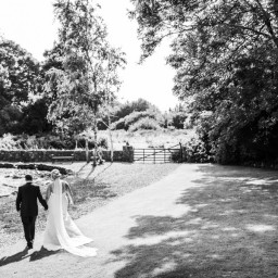 bride and groom walking in gardens of the king arthur hotel south wales