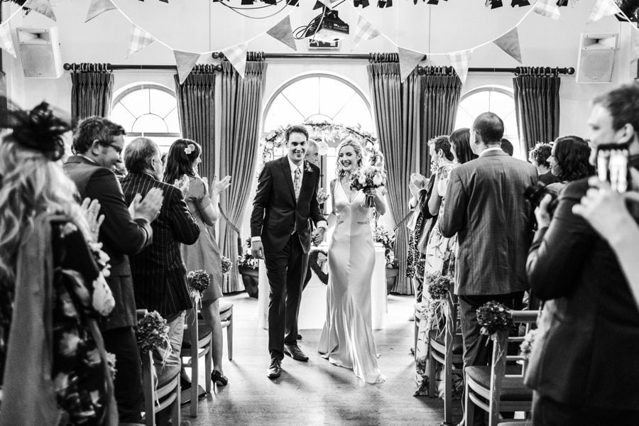bride and groom walking down the aisle at the King Arthur Hotel wedding