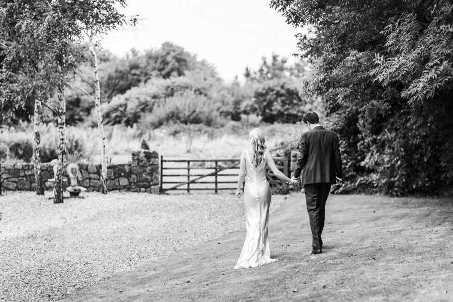 bride and groom walking in the garden at the king arthur hotel wedding