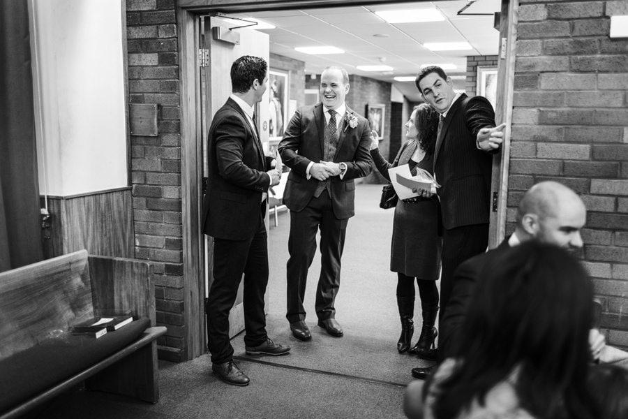 groom waiting at church wedding