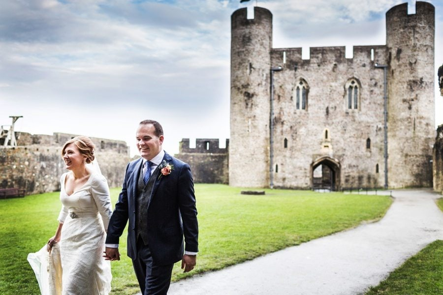 bride and groom photographed at caerphilly castle