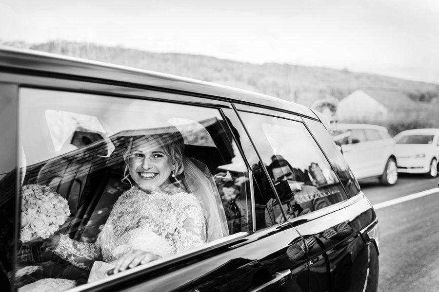 bride arriving at church in car