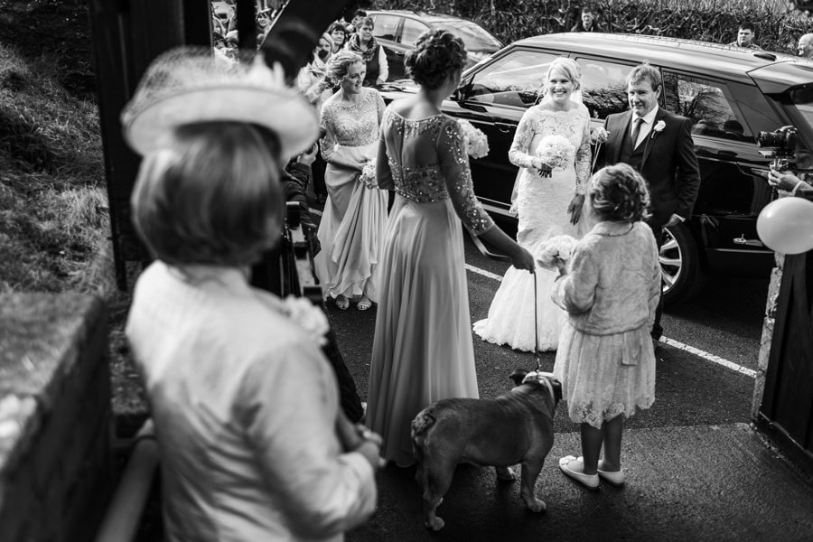 bride arrives at wedding ceremony in west wales church