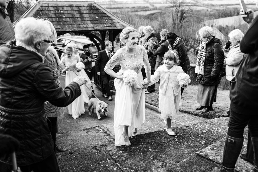 bridesmaid arrive at wedding ceremony in west wales church