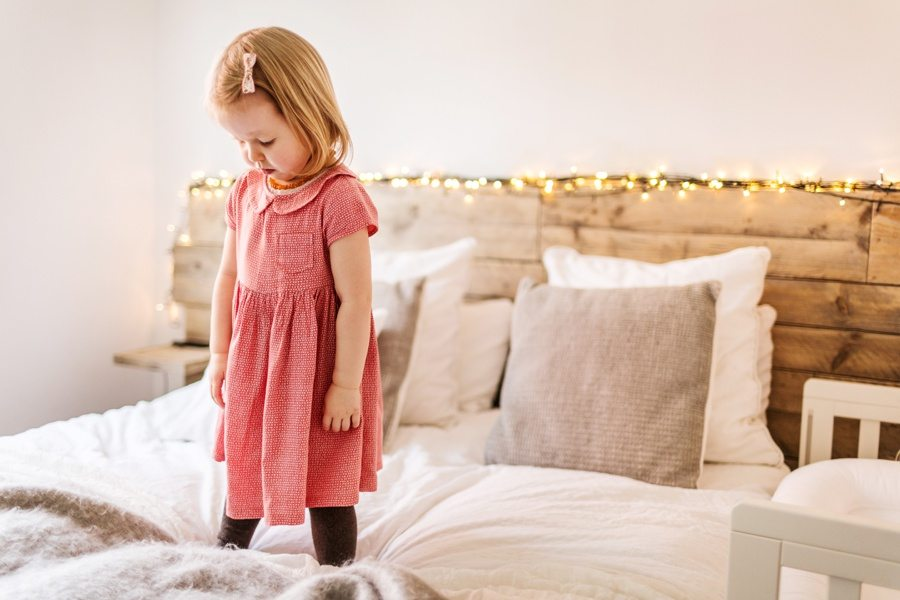 little girl on big bed