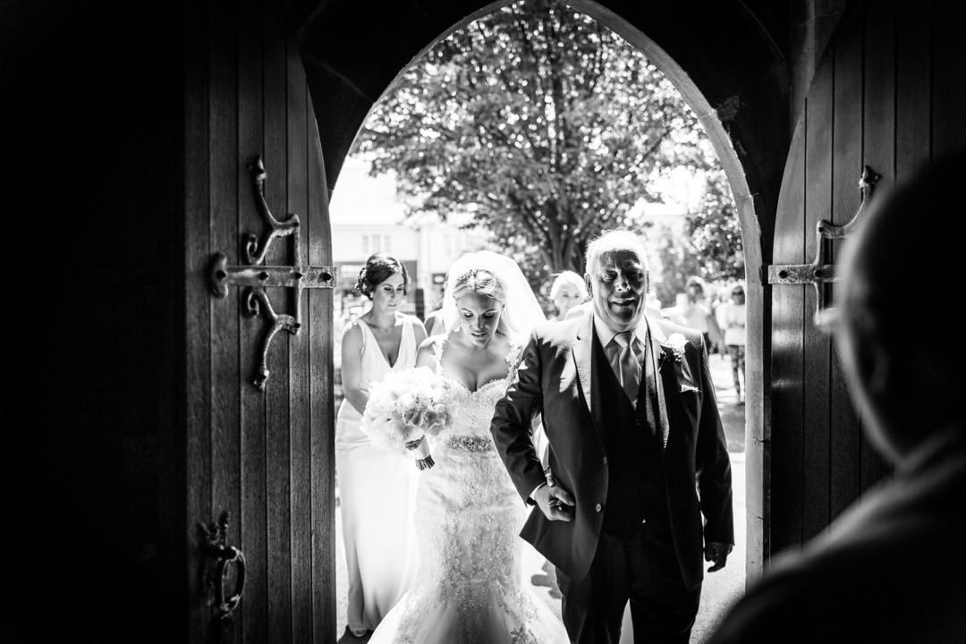 bride and father at church door
