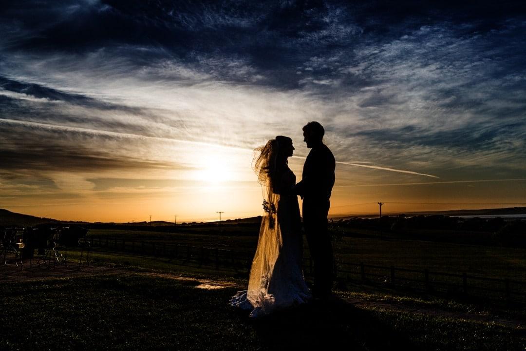 sunset at ocean view windmill wedding