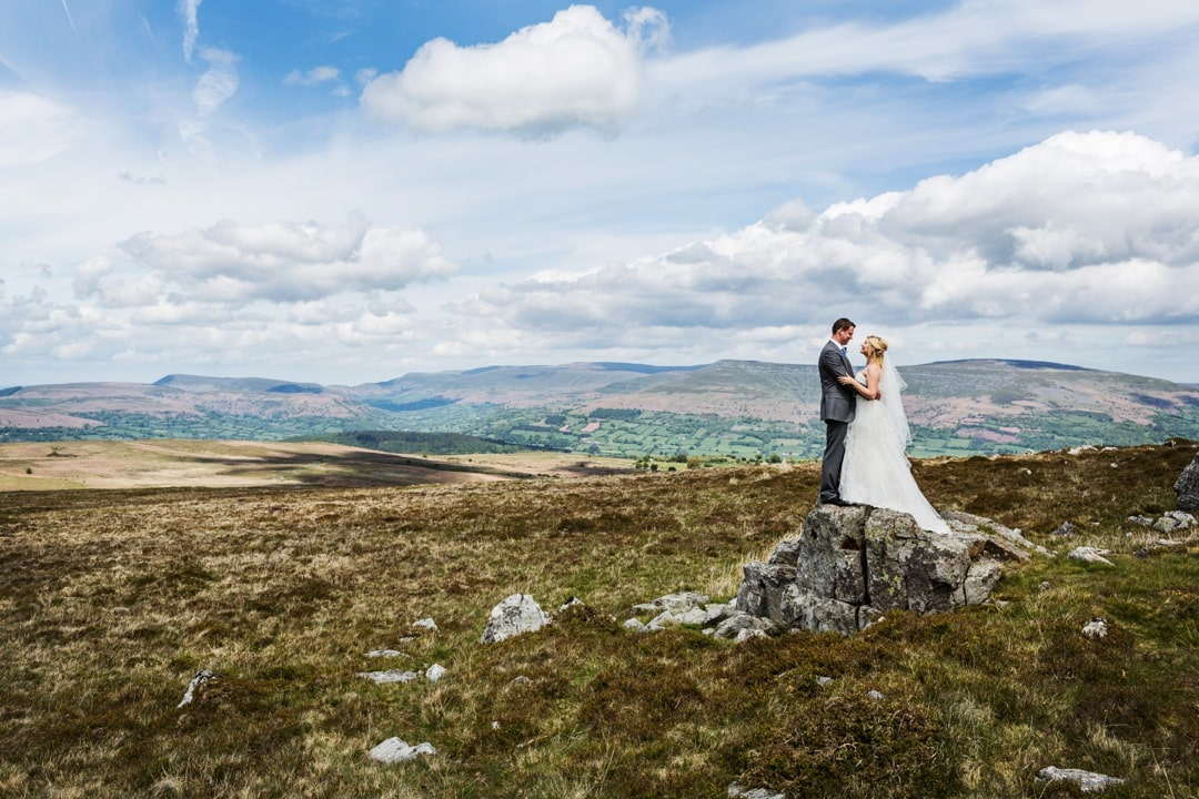 Bride and groom on Llangynidr mountain, South Wales