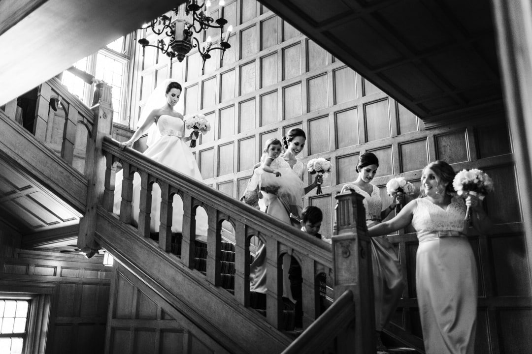 bride on stairs at coombe lodge