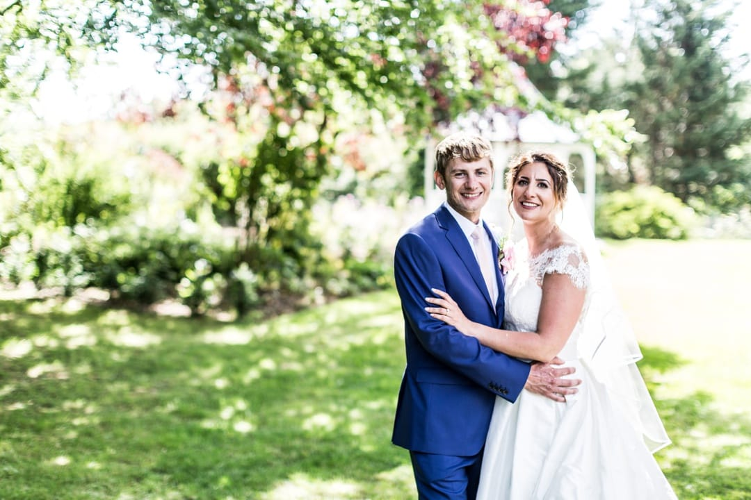Bride and groom in tree shade
