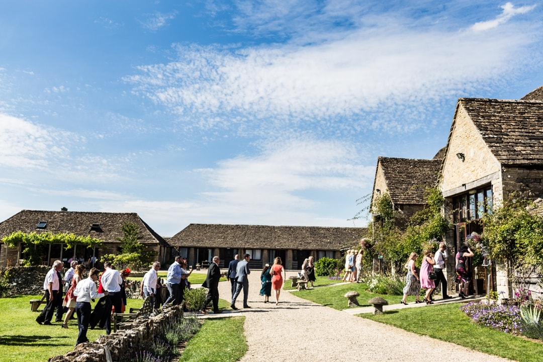 guests entering great tythe barn for wedding reception
