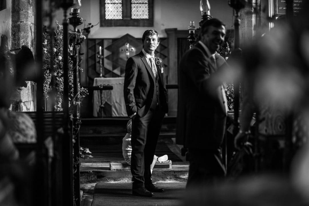 groom waiting at a church at south wales wedding