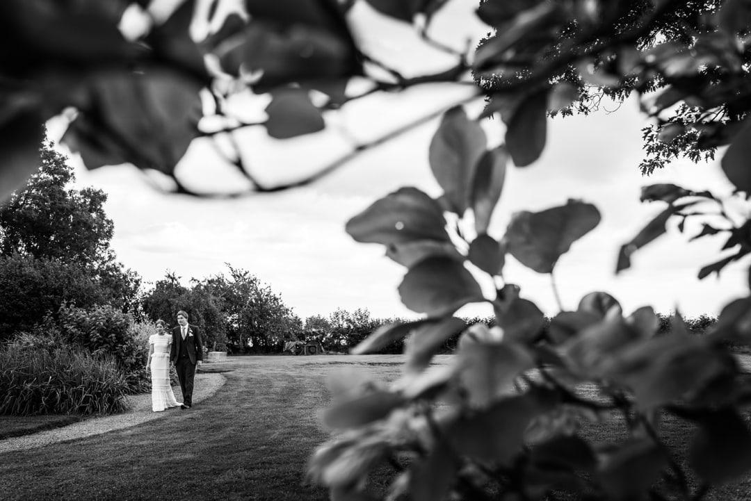 bride and groom walking church at south wales wedding