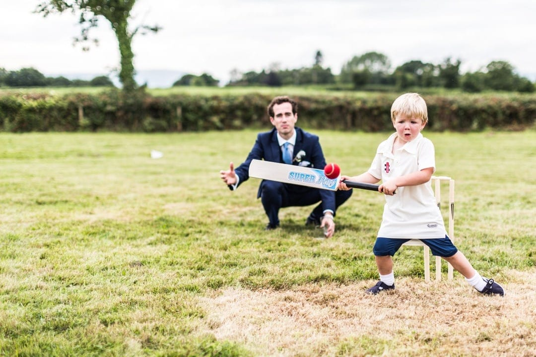 children playing cricket church at south wales wedding