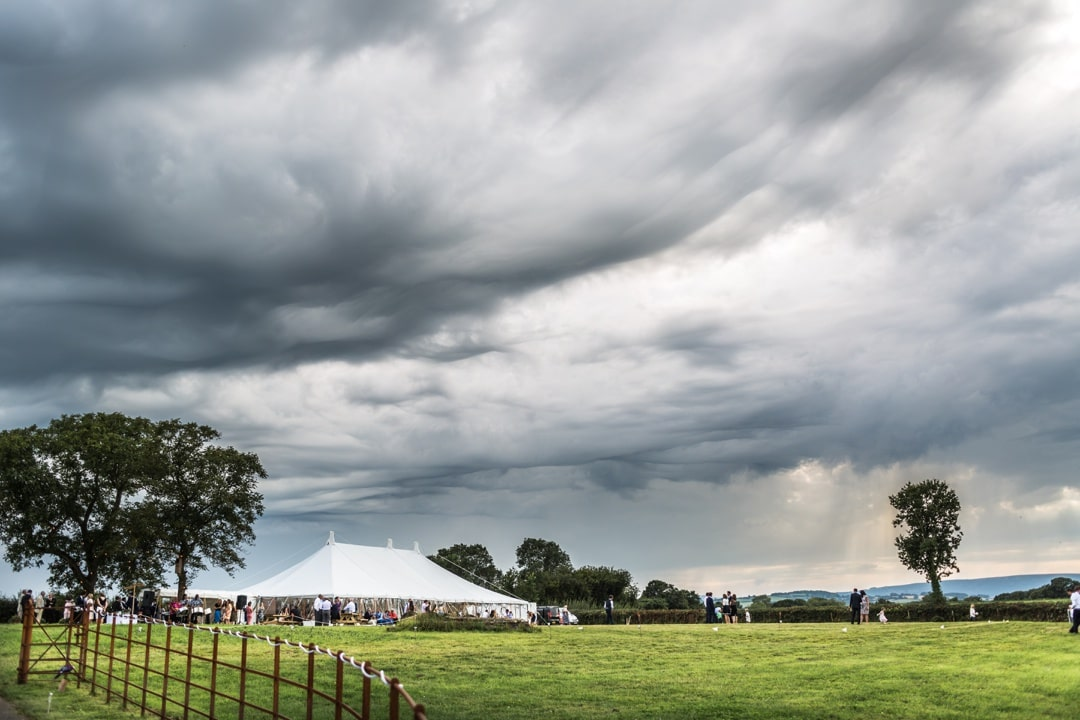 storm clouds over marquee at south wales wedding