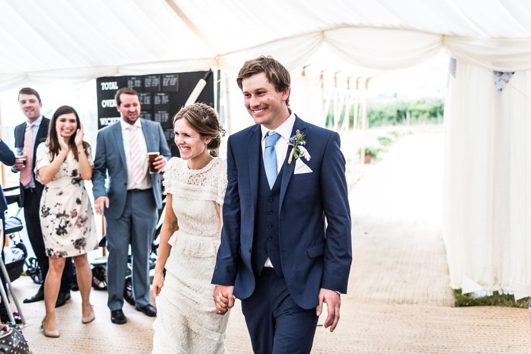 bride and groom entering marquee at south wales wedding