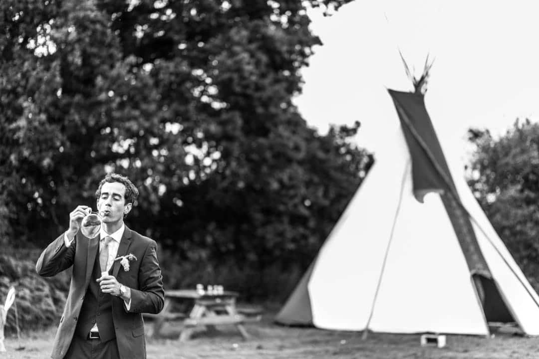 man blowing bubbles at south wales wedding