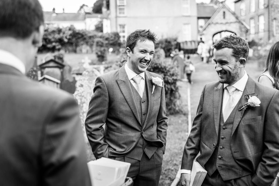 Groom laughing at Llandysul Parish Church Wedding