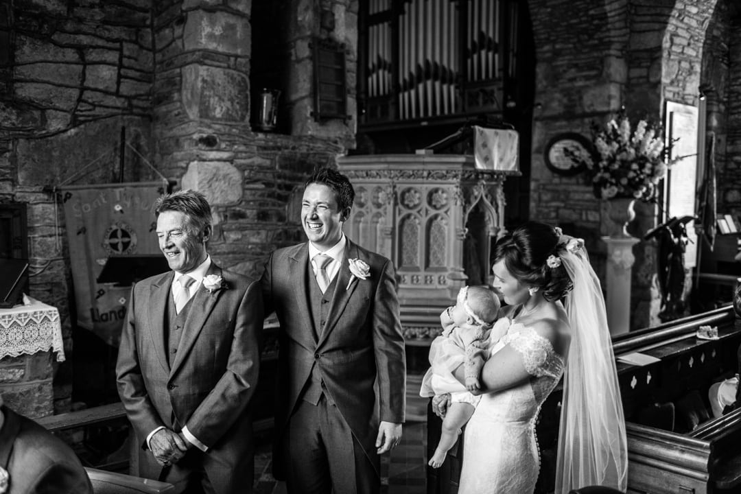 Marriage ceremony at Groom waiting at alter of Groom laughing at Llandysul Parish Church Wedding