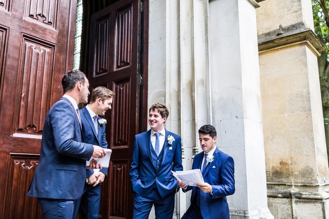 groom and ushers waiting at church
