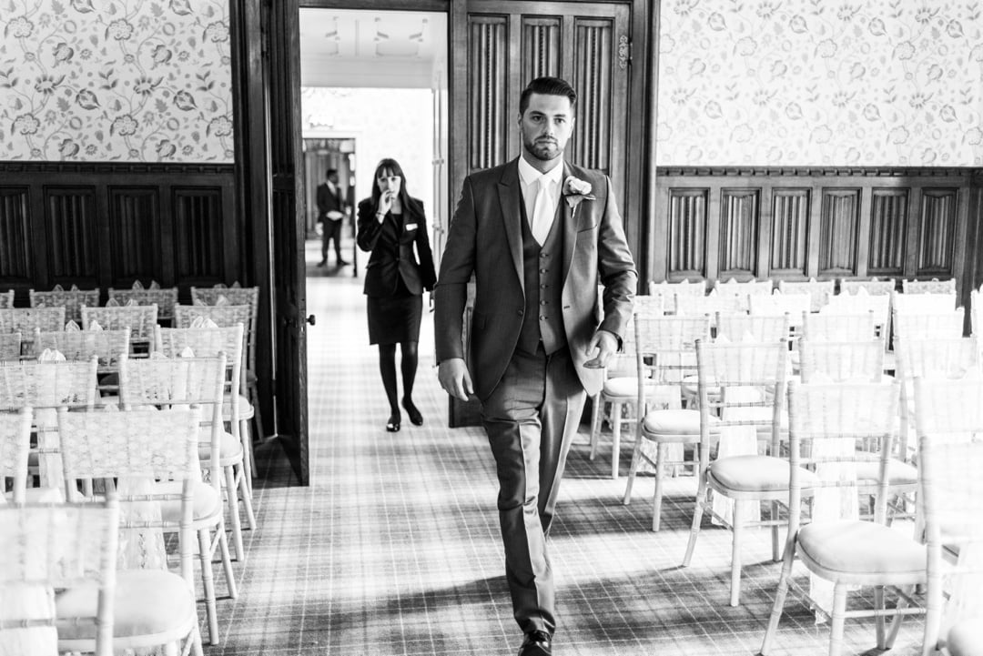 groom walking down aisle at hensol castle