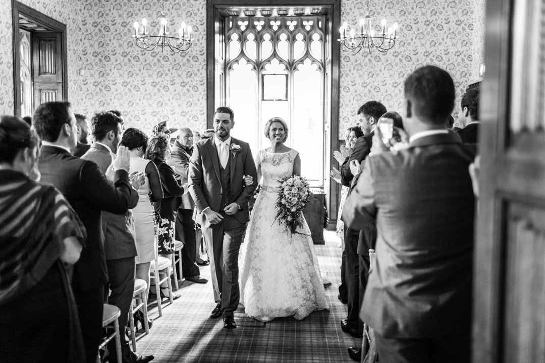 bride and groom walking down aisle at hensol castle wedding