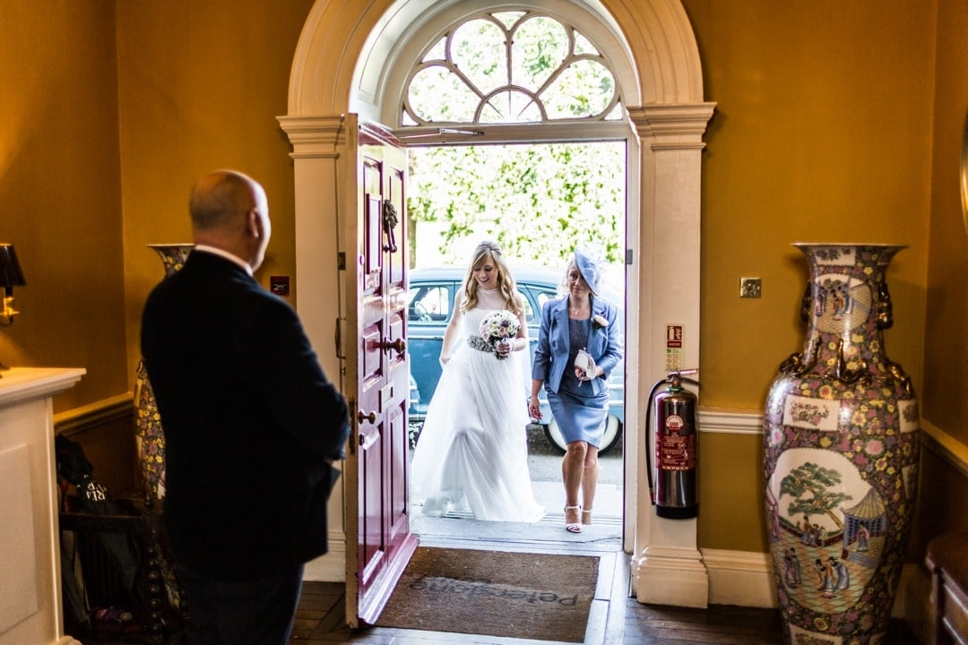 bride and mum walking though door