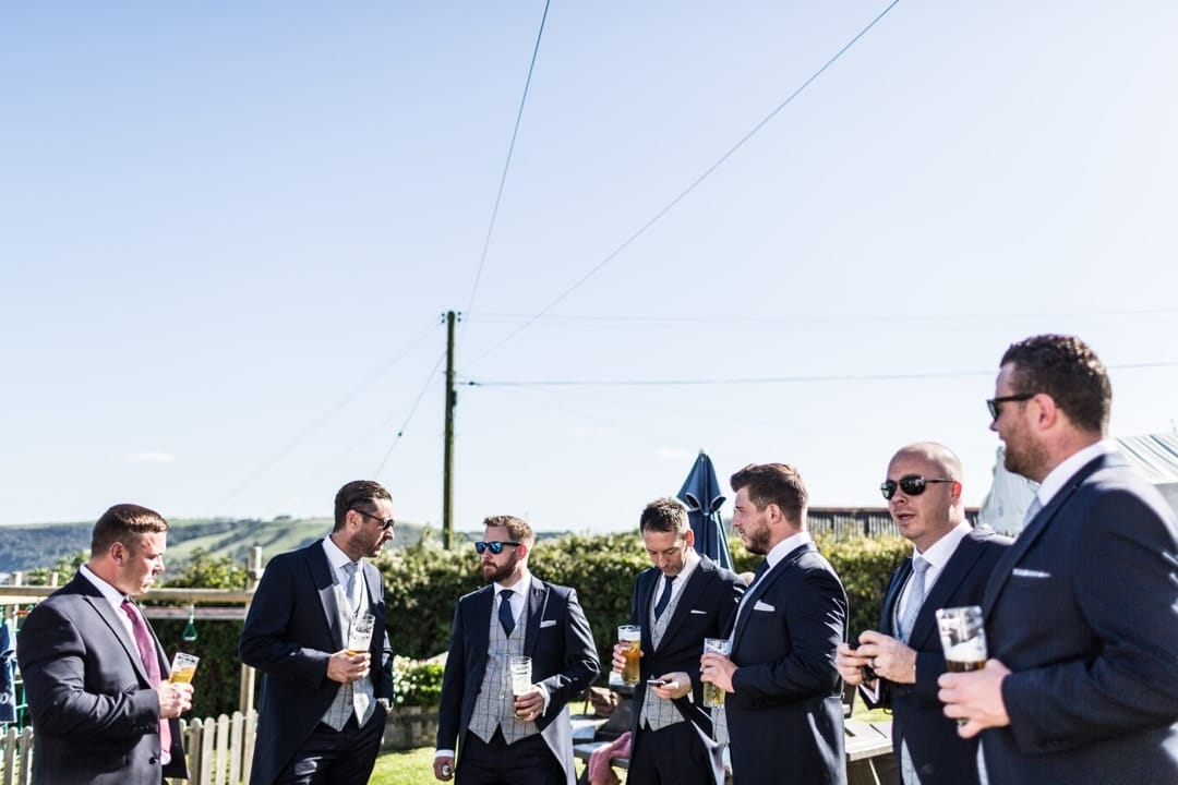 groom and ushers having drink