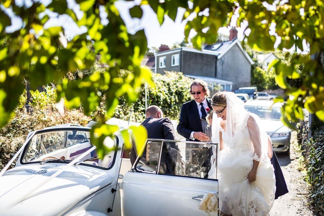 bride arriving in beetle car