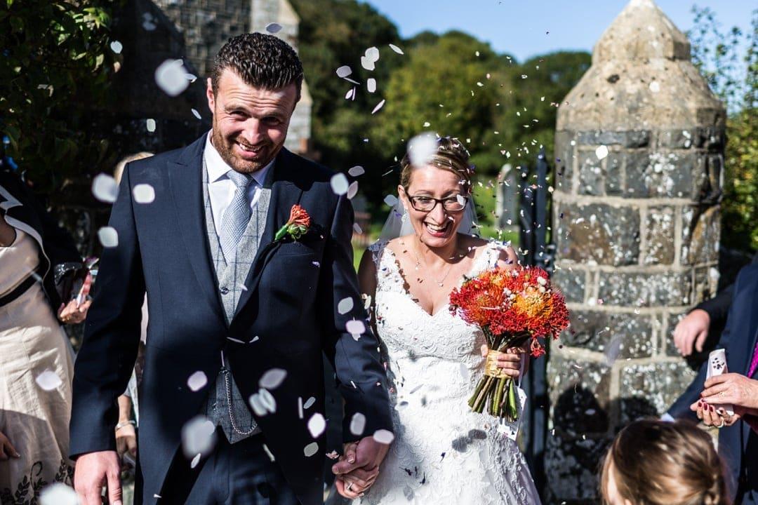 bride and groom in confetti