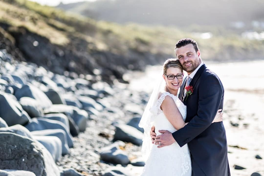 bride and groom on beach at New Quay, Ceredigion