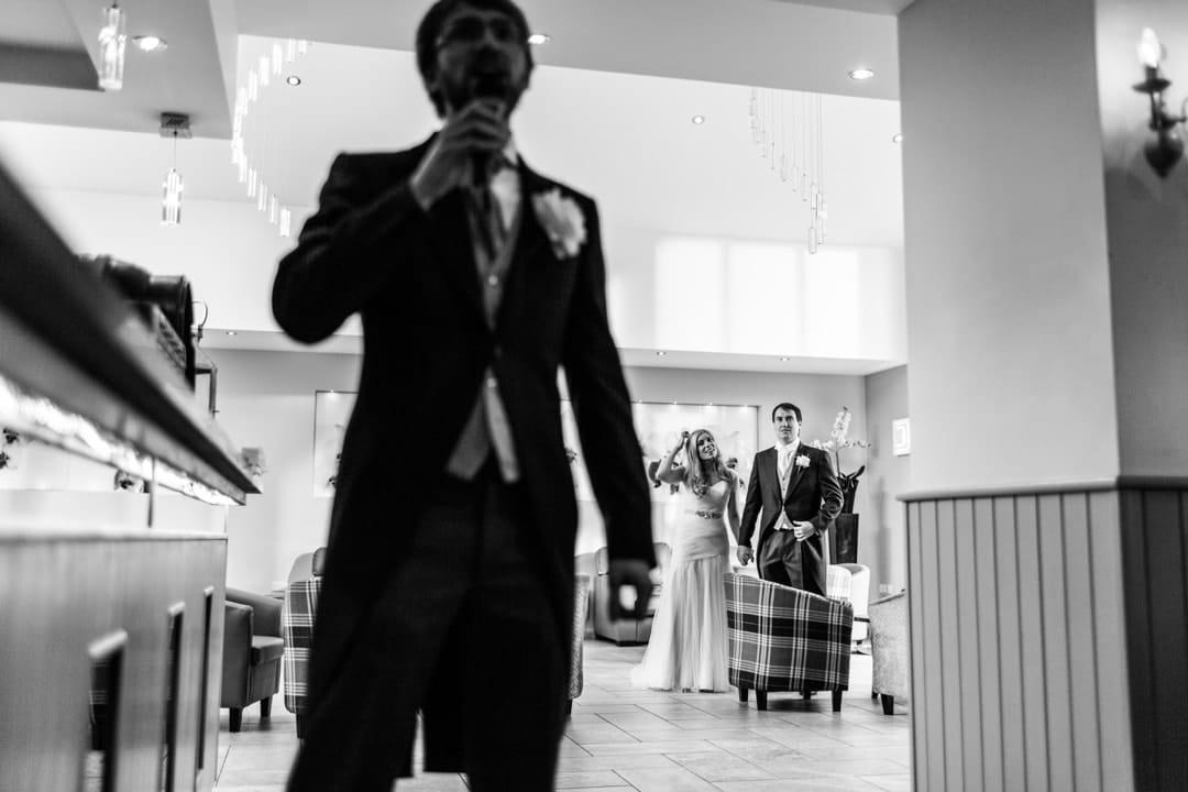 wedding couple make entrance at wolfcastle hotel