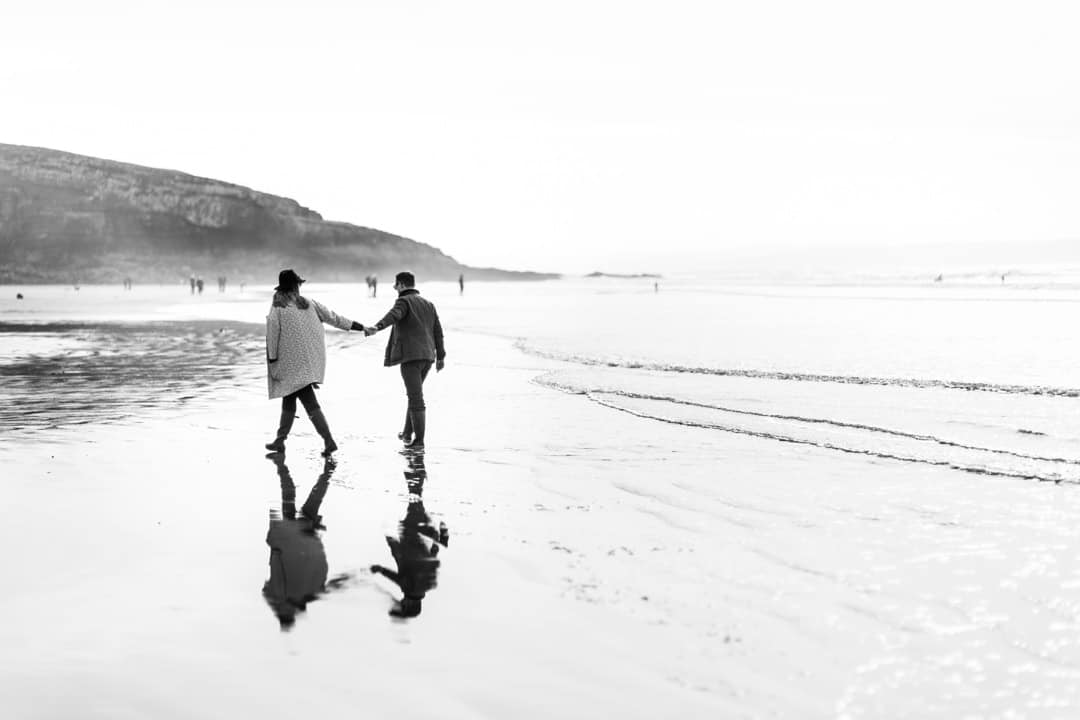 pre wedding portrait of bride and groom on beach in south wales