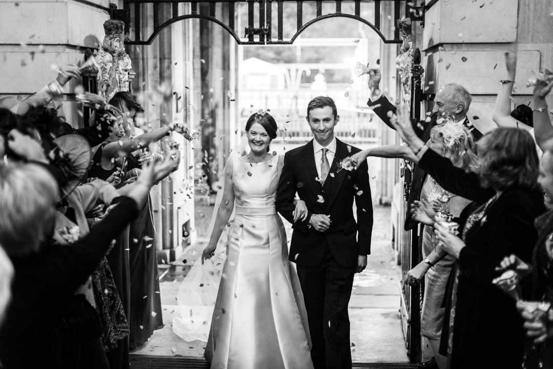 bride and groom arrives at cardiff city hall wedding