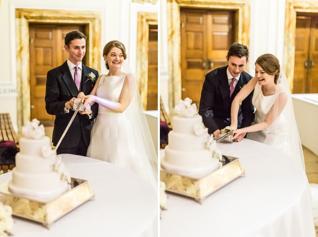 bride and groom cut cake at Cardiff city hall wedding