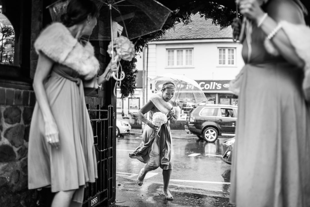 bridesmaid in rain at St Isaans Church in Llanishen, Cardiff