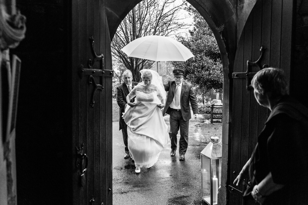bride arrives in rain at St Isaans Church in Llanishen, Cardiff