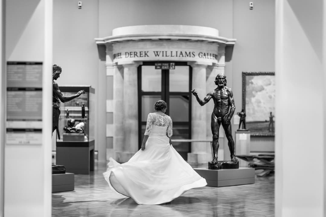 bride twirls dress at Cardiff Museum at night