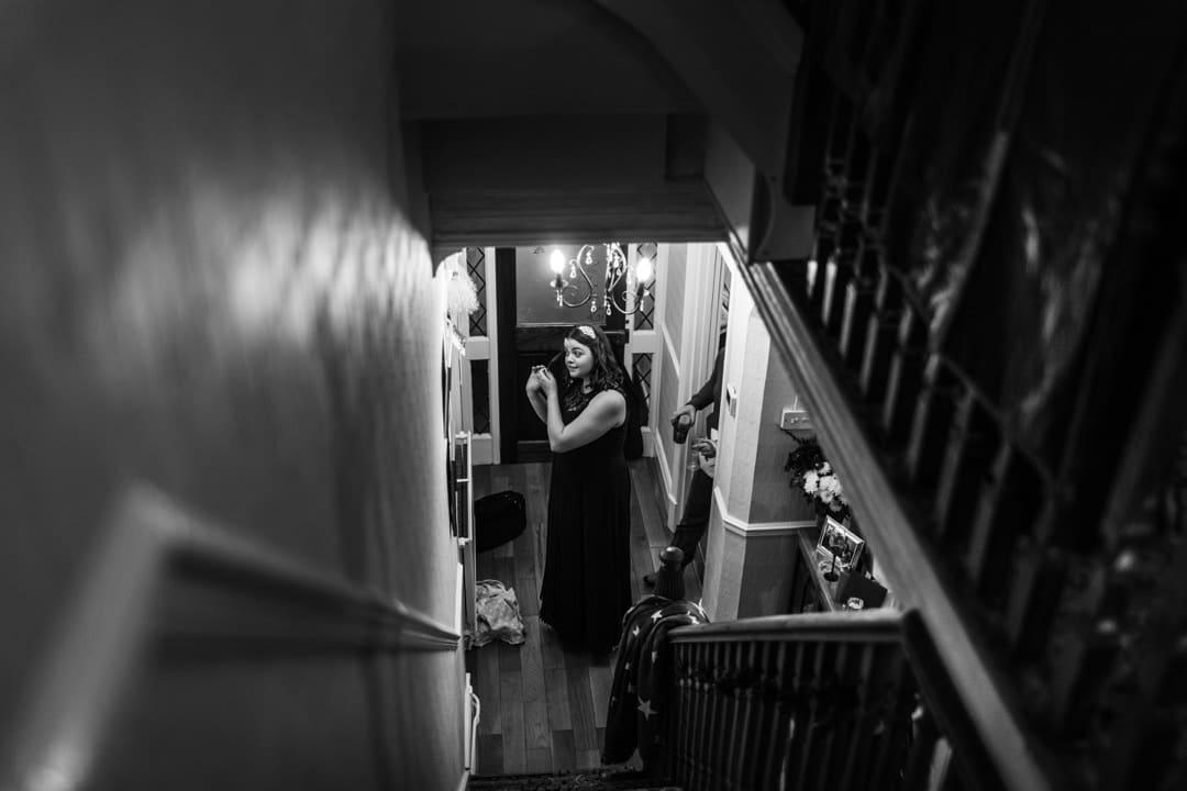 bridesmaid in front of mirror