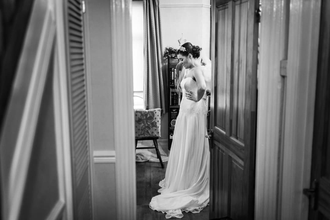 bride having dress put on