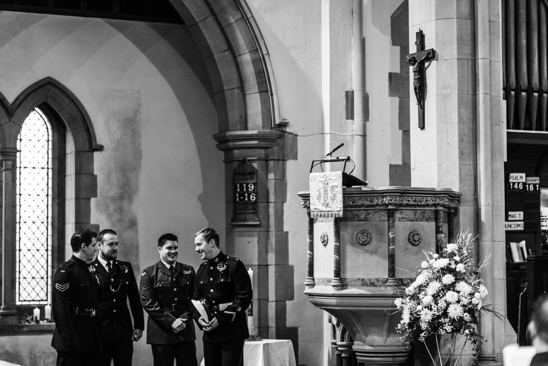 military groom waiting at church
