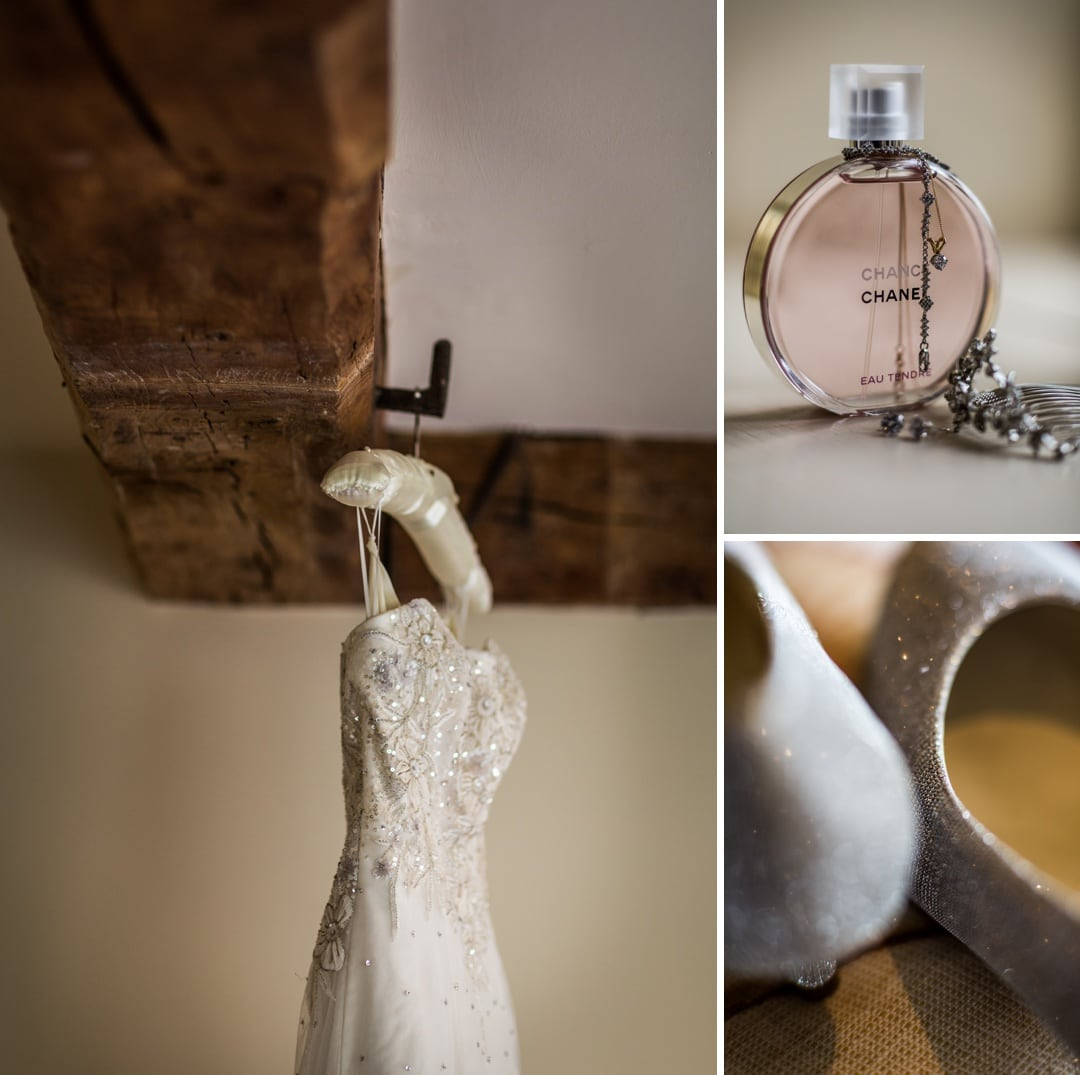 wedding dress hanging on exposed beam at Dewsall Court