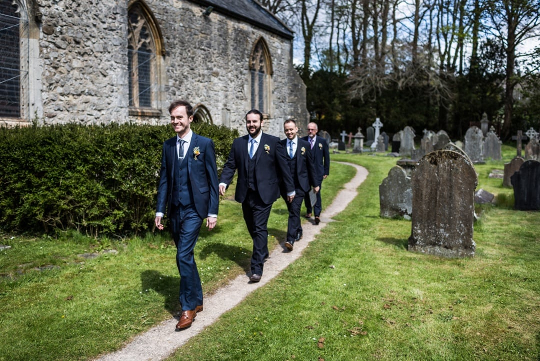 groom walks to church for wedding