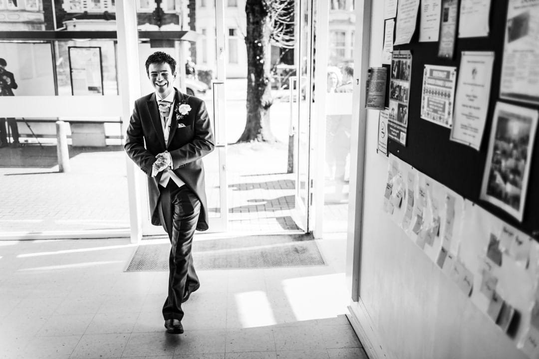 groom enters church door